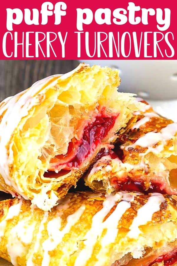 """closeup of three turnovers cut in half on a wood cake stand with a white bowl of cherries behind it with text """"puff pastry cherry turnovers"""""""