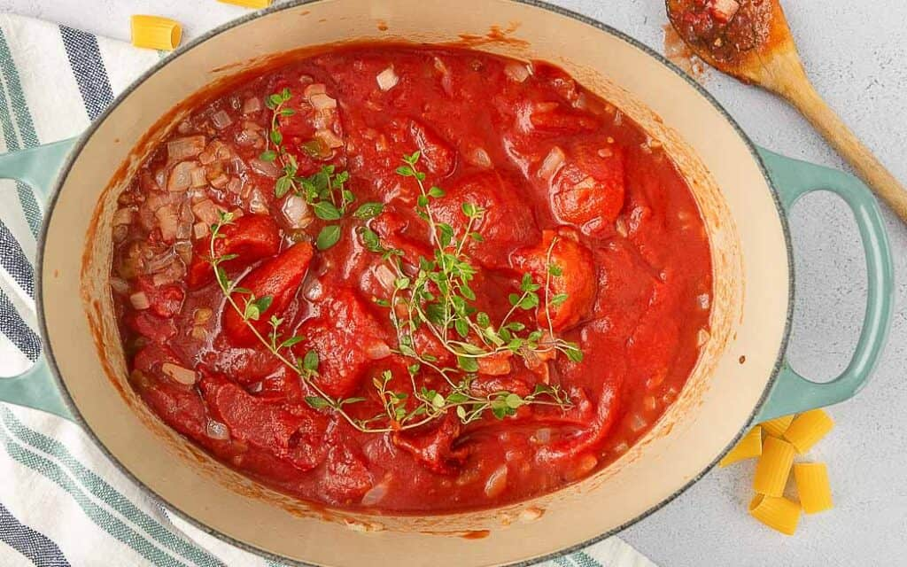 open dutch oven with tomato sauce