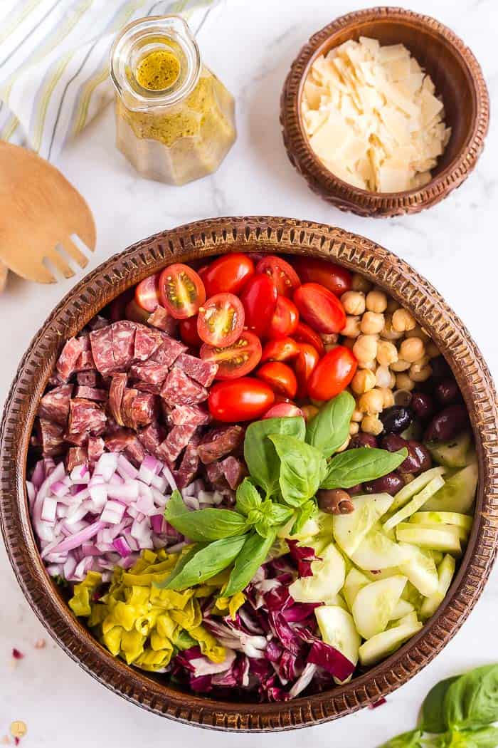 overhead picture of an chopped salad with toppings in sections