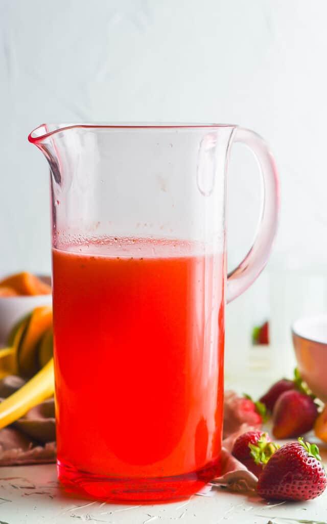 glass pitcher of strawberry lemonade