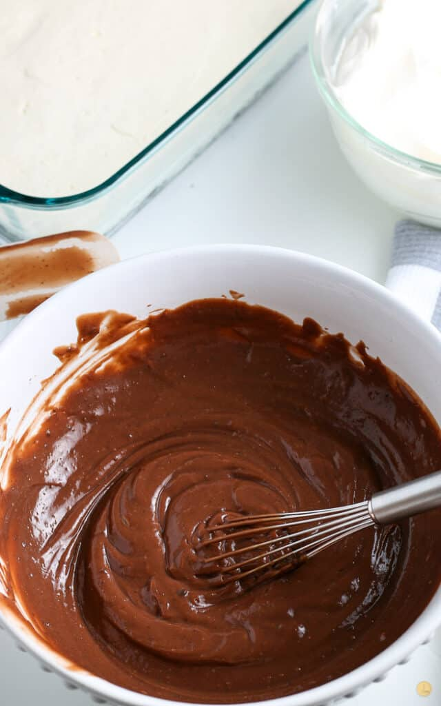 chocolate pudding mix in a white bowl with a whisk
