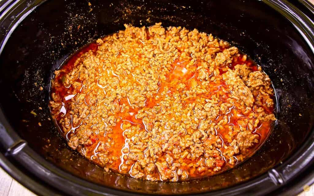 cooked taco meat in a crock pot bowl