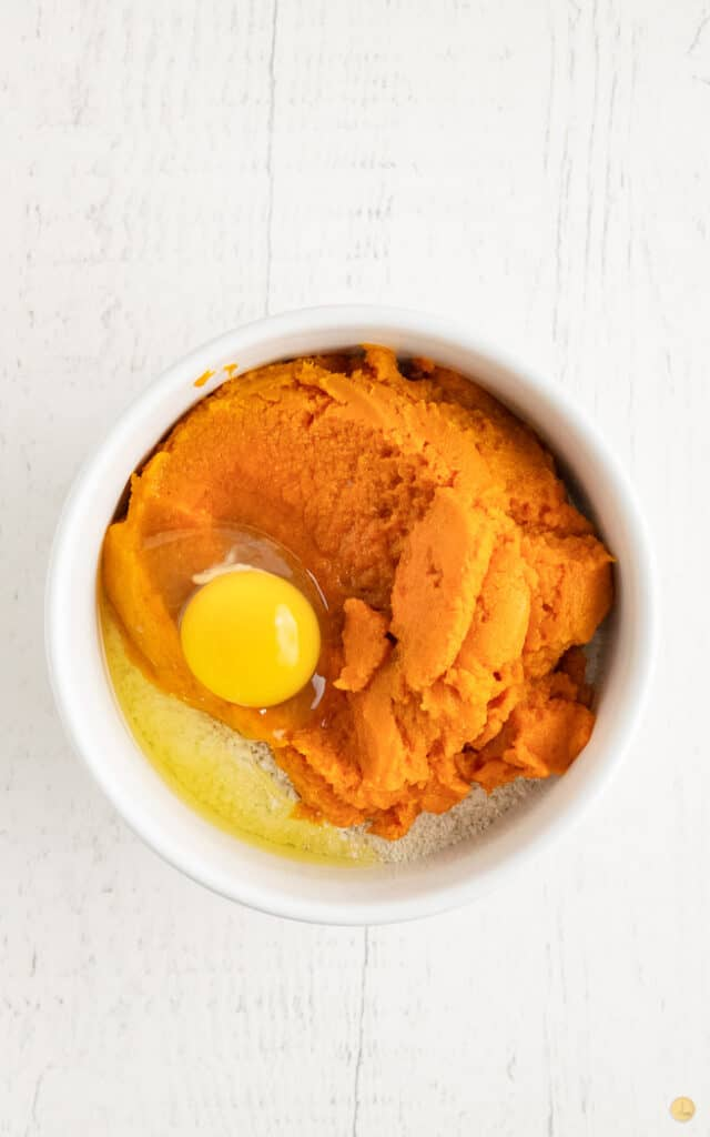 pumpkin puree in a white bowl with egg