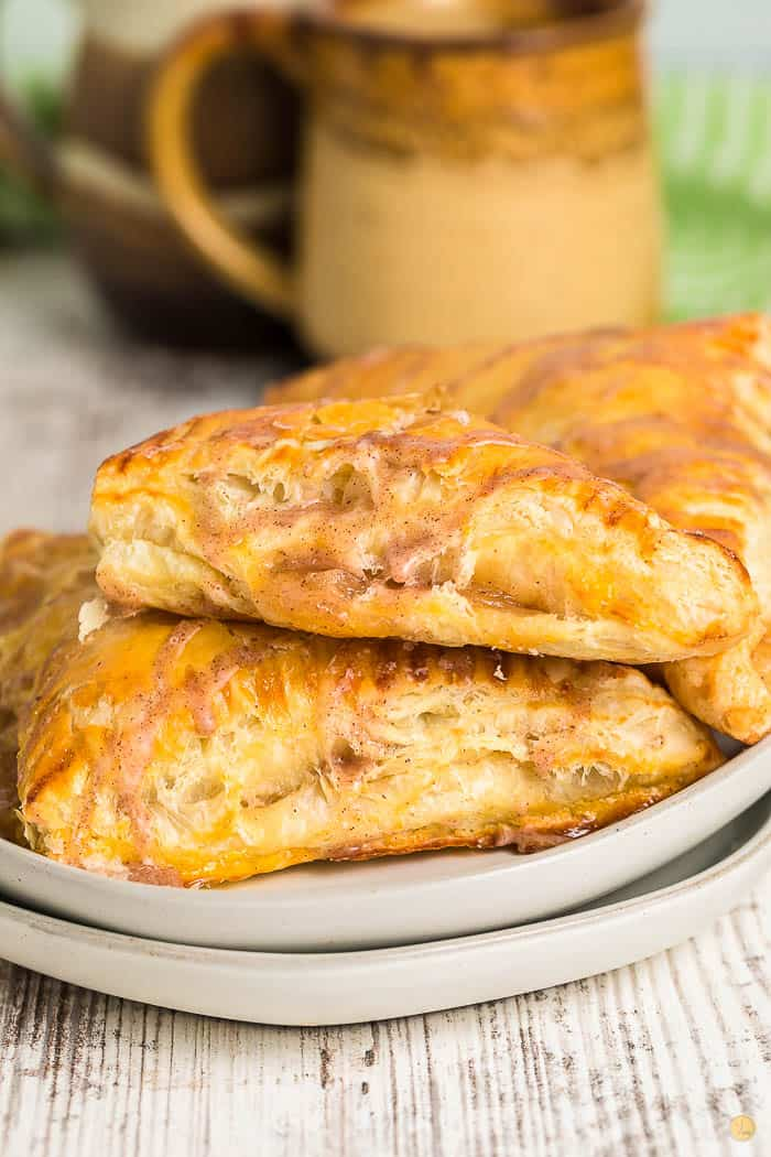 two turnovers on a stack of grey plates
