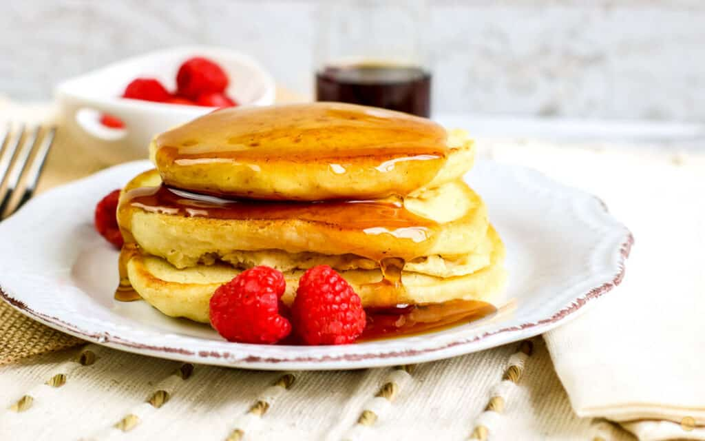 side view of stack of pancakes with berries