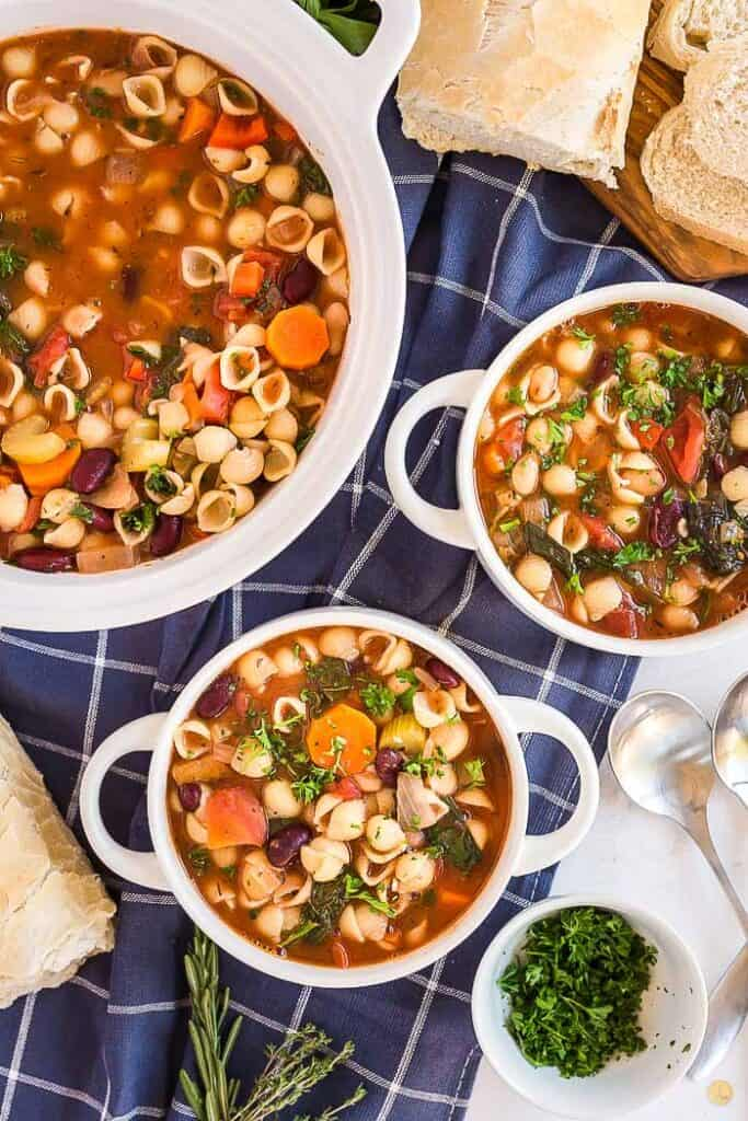 overhead picture of two bowls of soup next to a pot of soup