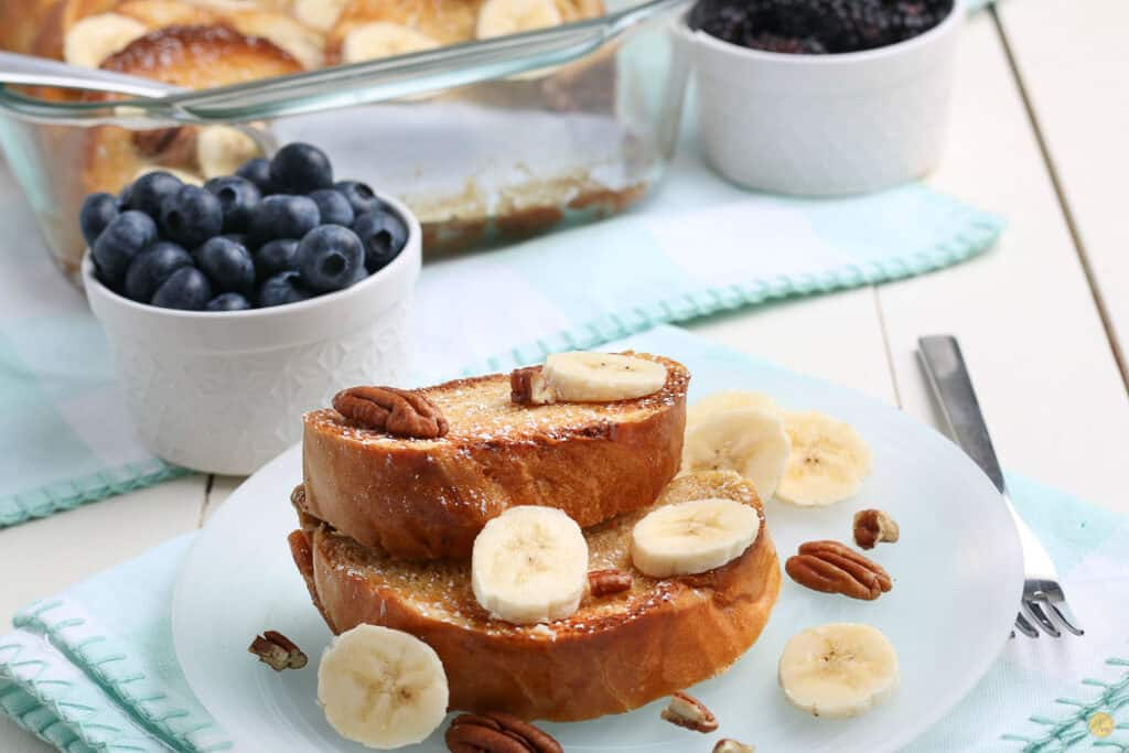 two slices of french toast with bananas on a blue plate