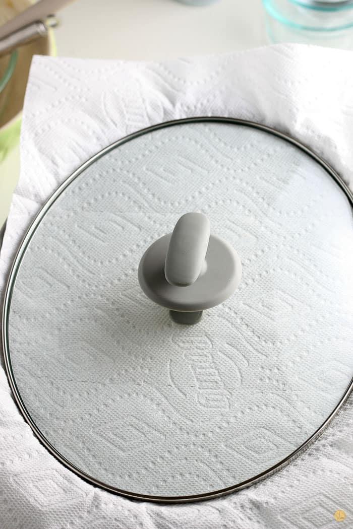 crock pot lid over paper towels