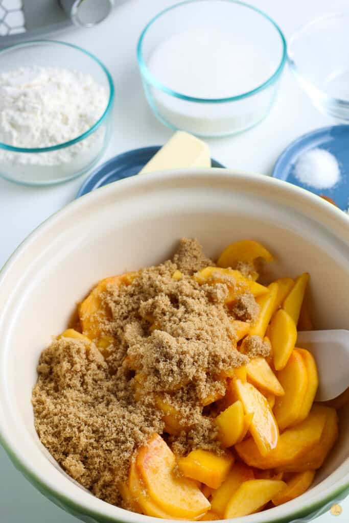 peaches and brown sugar in a bowl