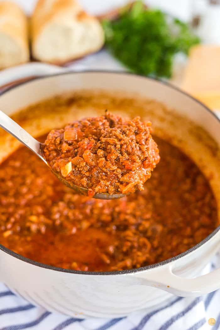 pot of meat sauce with a ladle of sauce