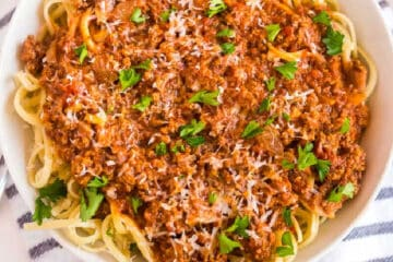 square picture of bowl of spaghetti and meat sauce
