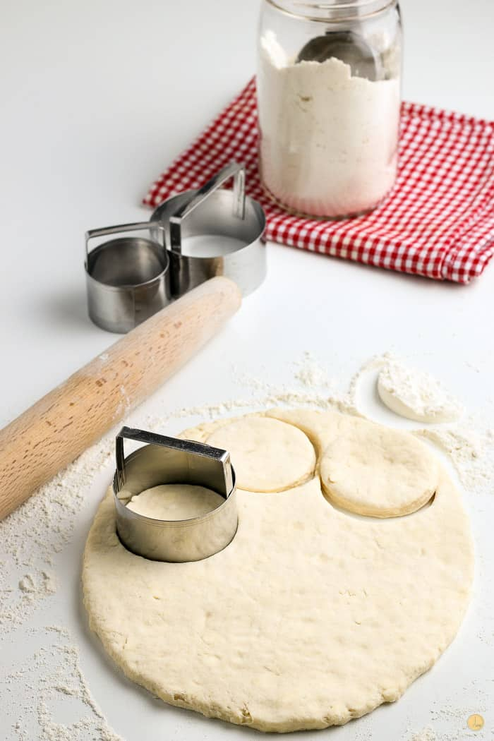 biscuits being cut out of dough