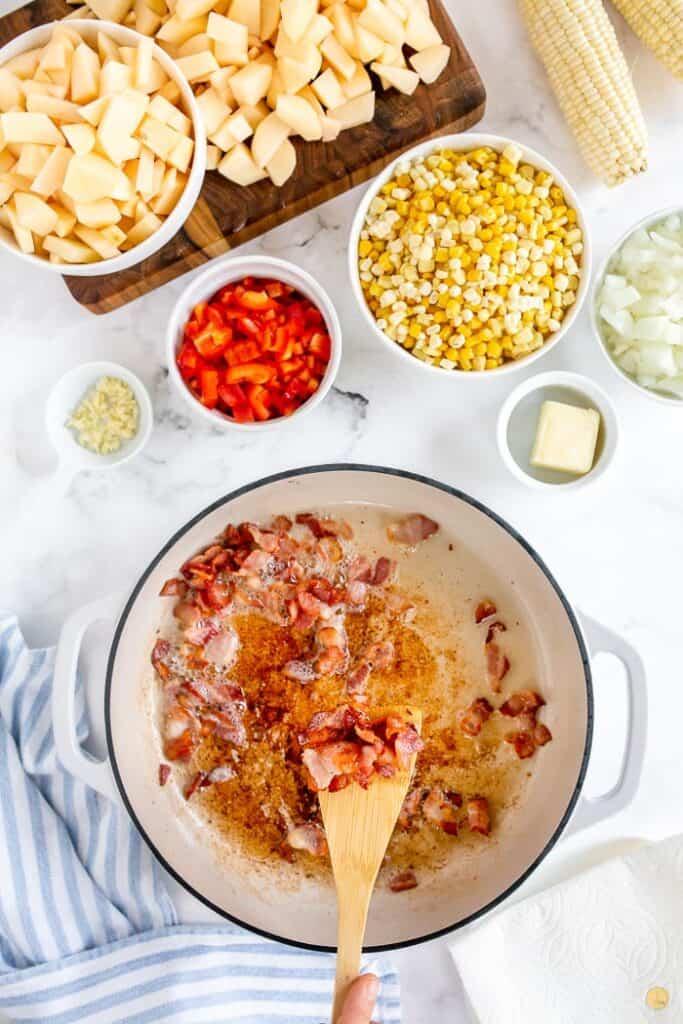 bacon frying in pot