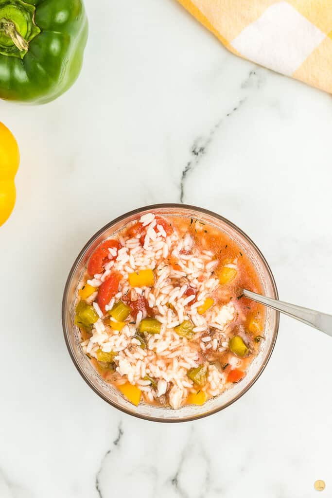 stuffed bell pepper soup in a clear bowl