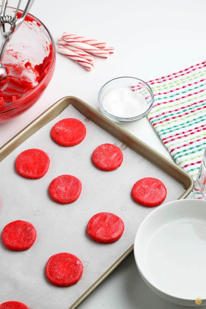 unbaked red cookies on baking sheet