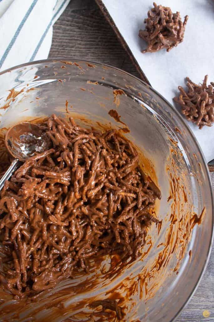 chocolate coated noodles being scooped into a bowl