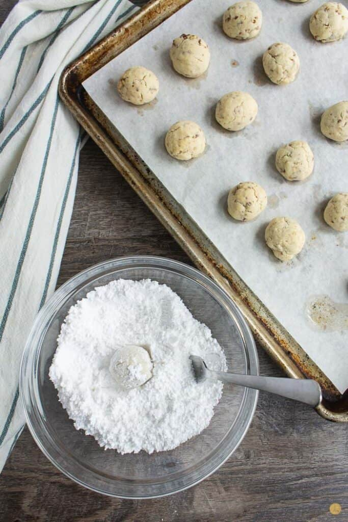 cookie and powdered sugar in a bowl with a fork
