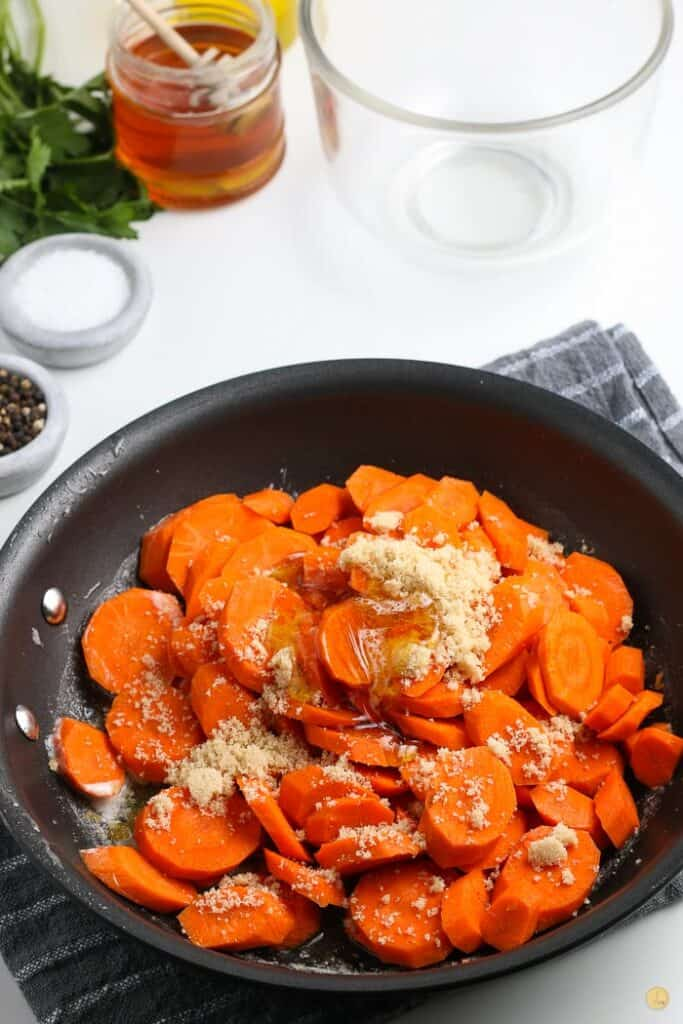 carrots and spices in a pan