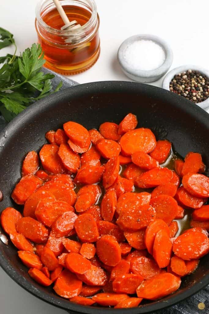 cooke carrots in a pan