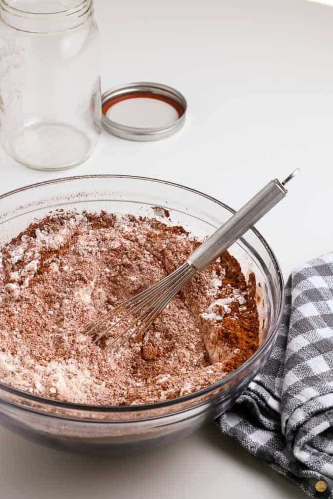 hot cocoa mix in a bowl with whisk