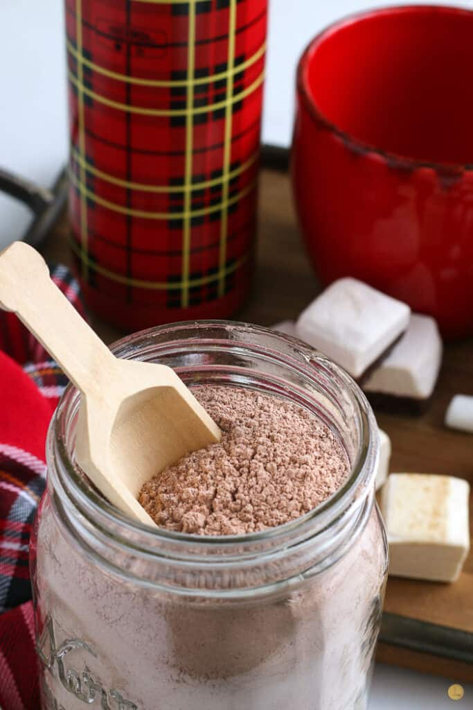 diy hot chocolate mix in a jar with a wood scoop