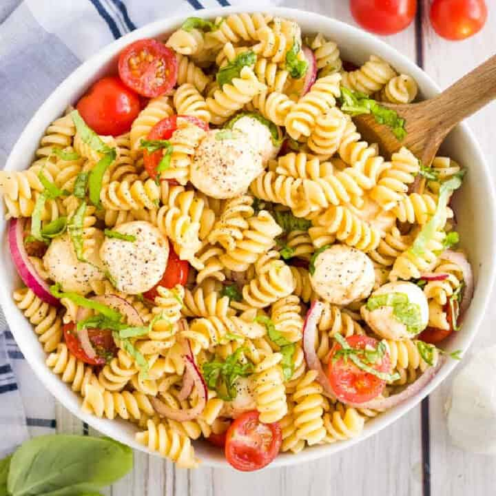 overhead bowl of pasta and tomatoes