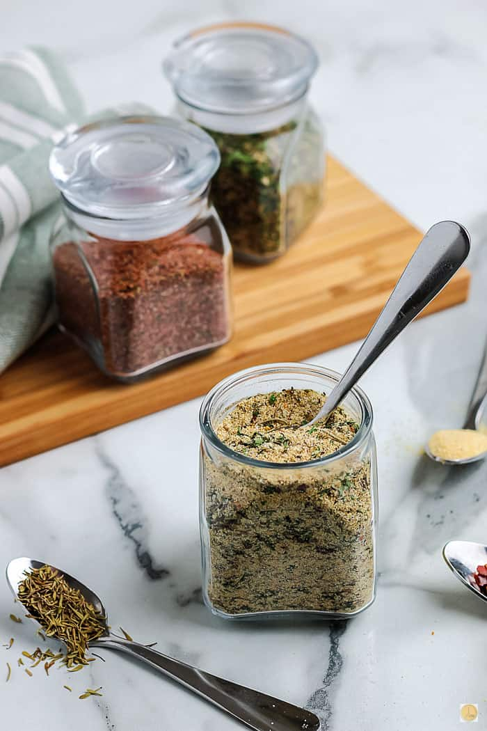 jar of seasoning with a spoon in it