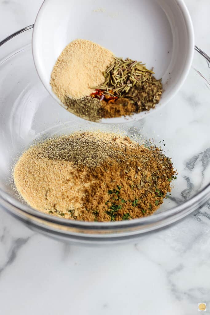 spices pouring into a bowl