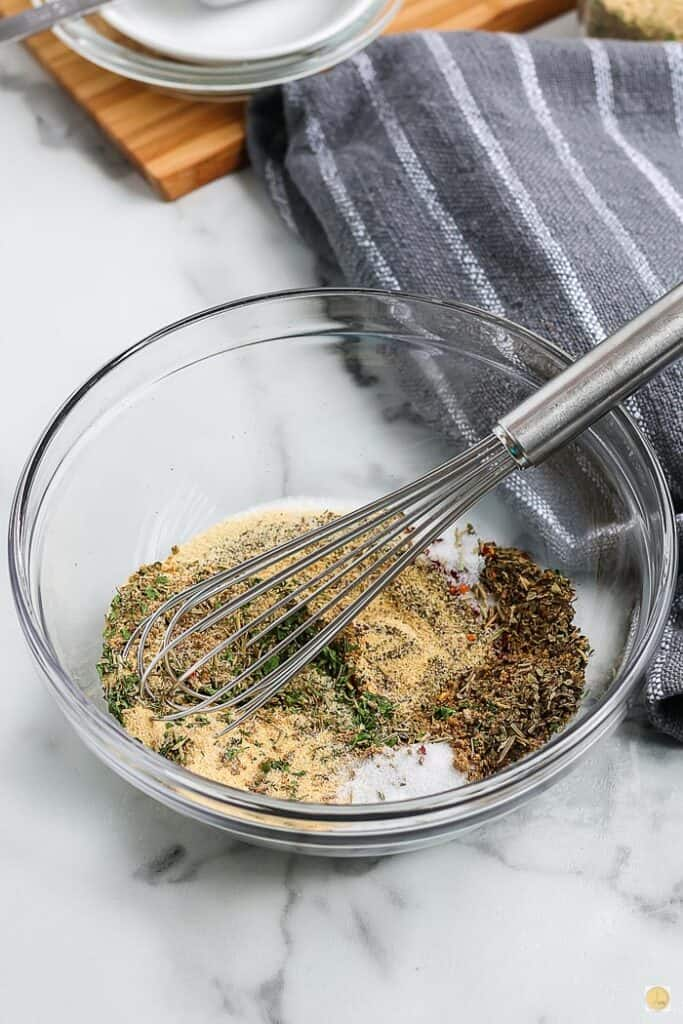 bowl of spices being mixed with a whisk