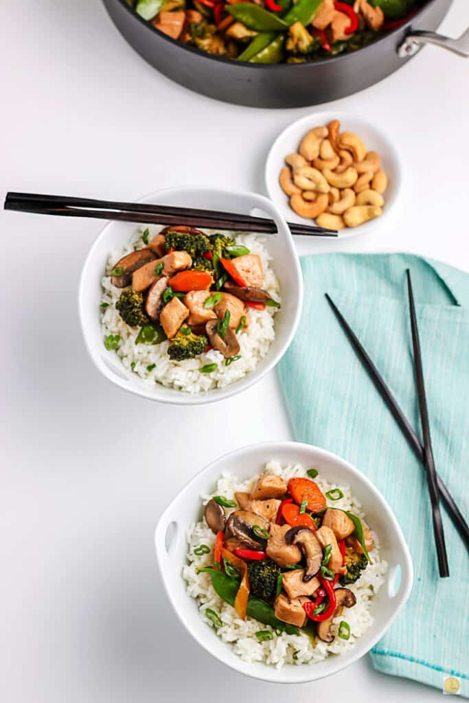two bowls of stir fry
