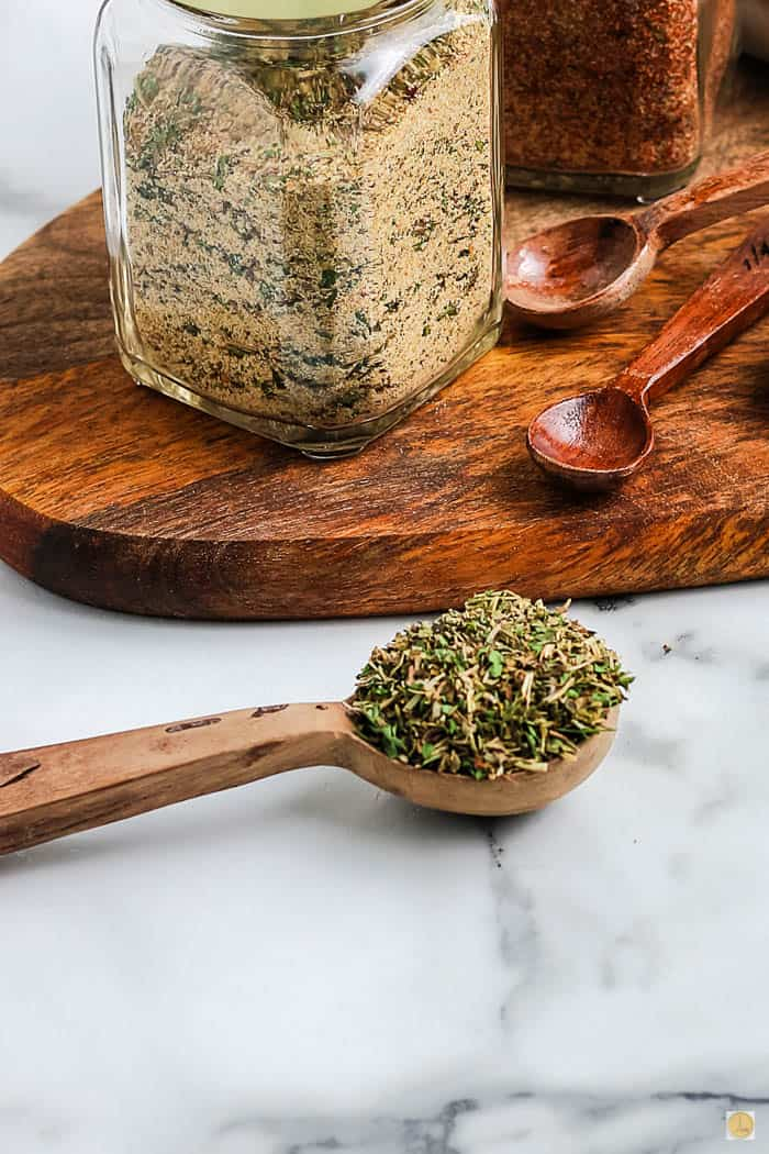 spoon of seasoning on marble countertop