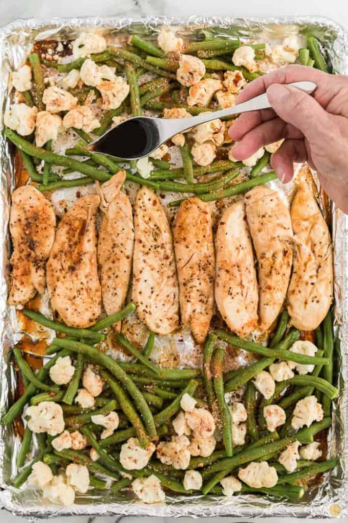 veggies and chicken on a baking sheet