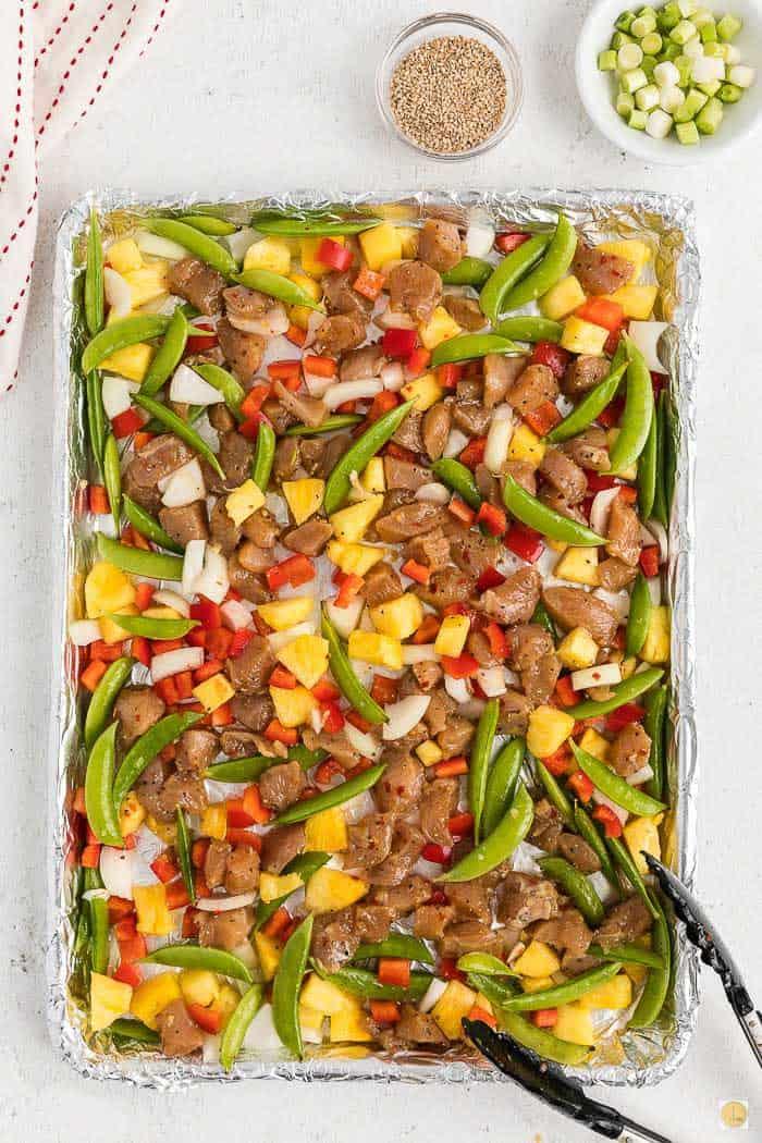 chicken and veggies on baking sheet