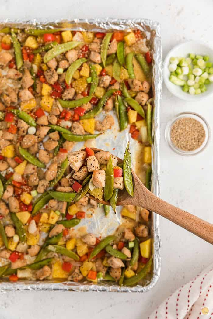 spoon scooping out chicken and vegetables