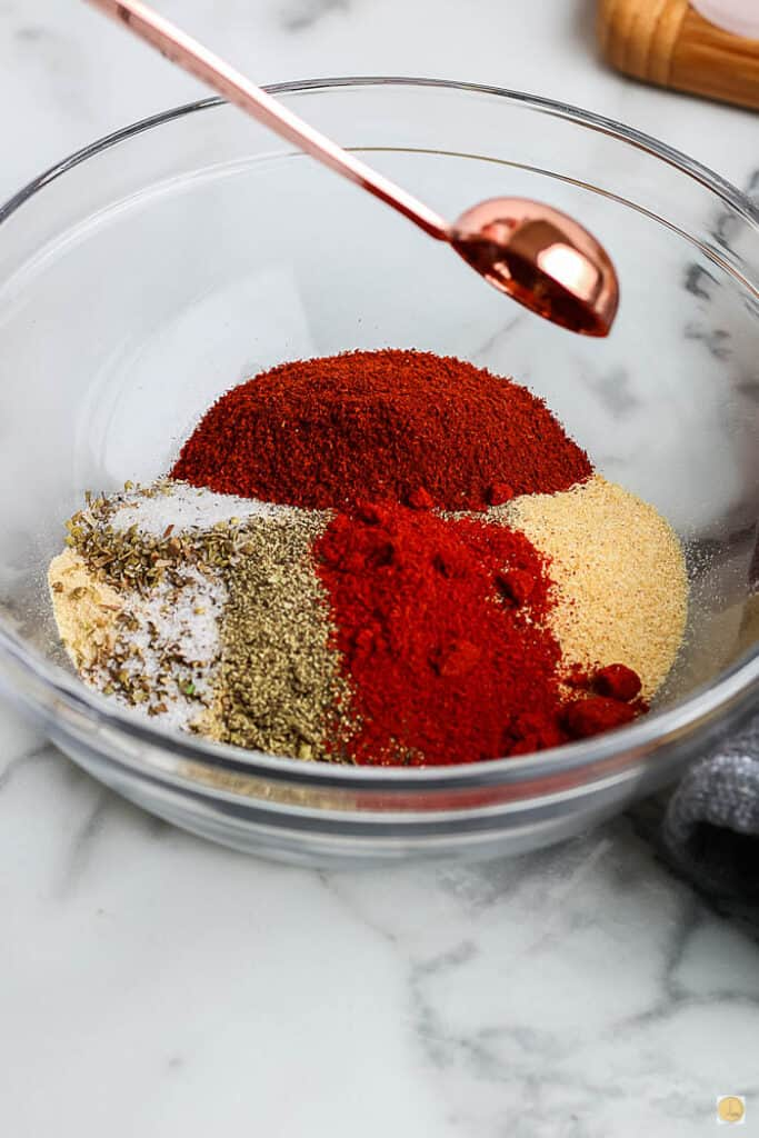 individual spices in a bowl