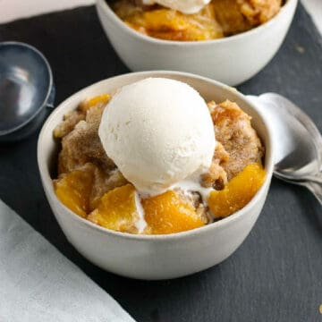 two bowls of peach cobbler