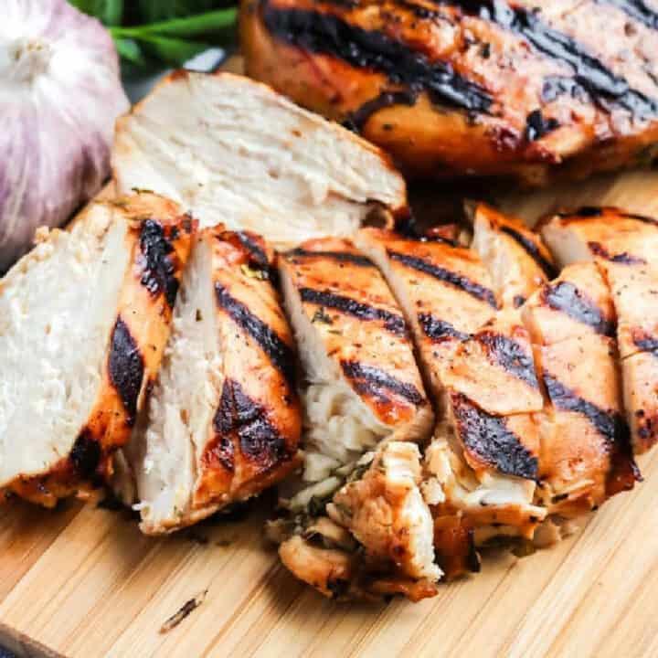 sliced chicken on a board