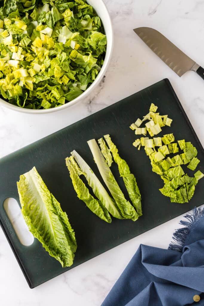 chopped lettuce on a cutting board