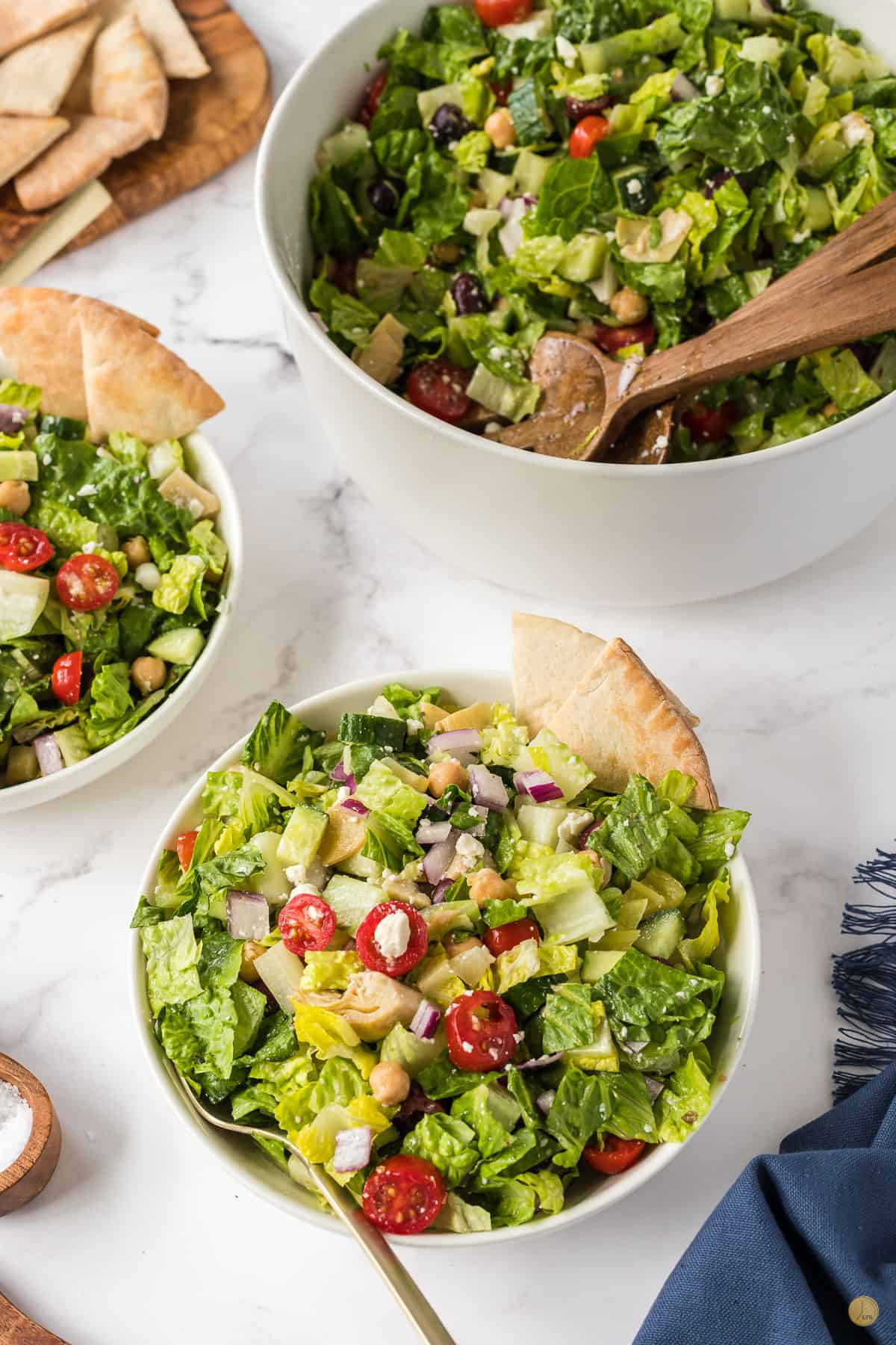 three bowls of salad