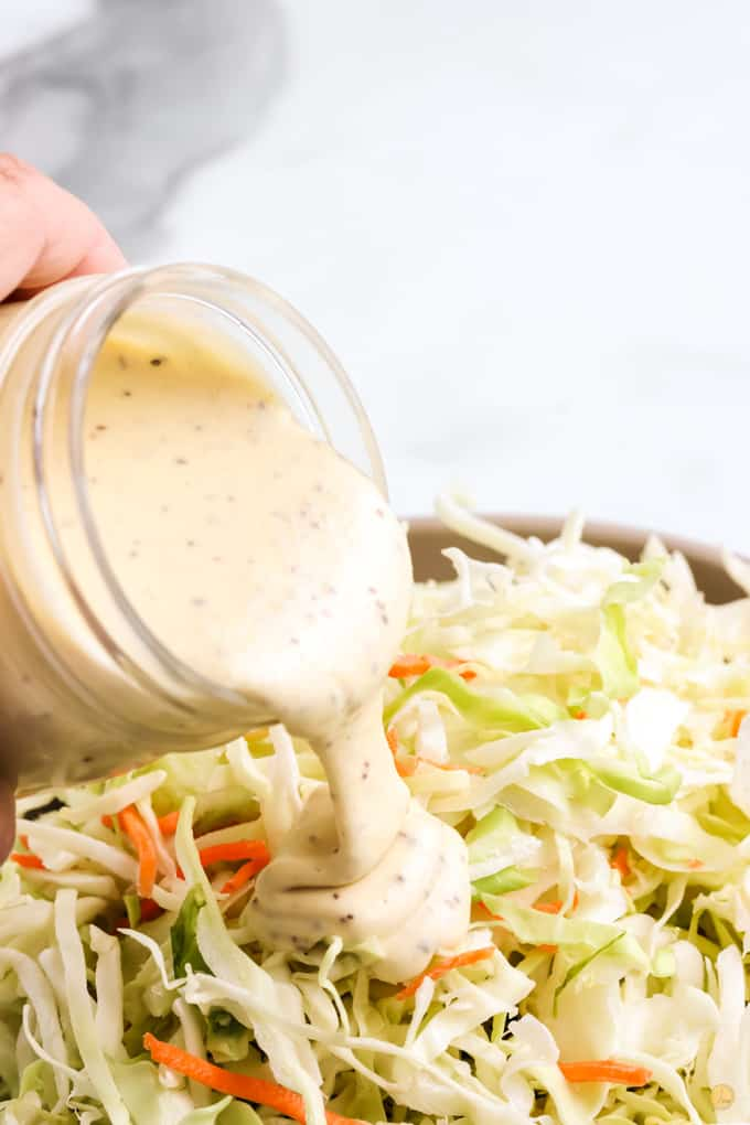 pouring dressing on slaw