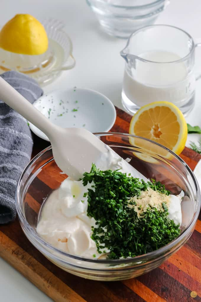 dressing ingredients with a spatula