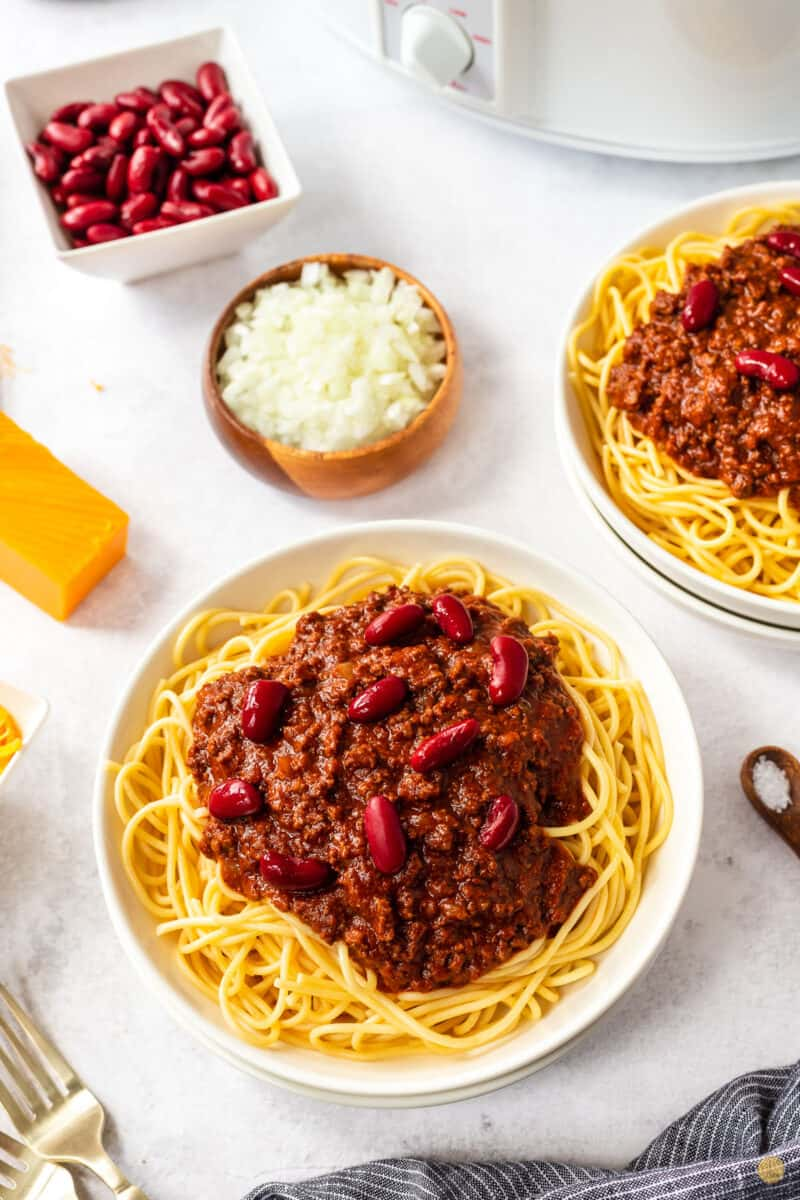bowl of chili, spaghetti, and beans