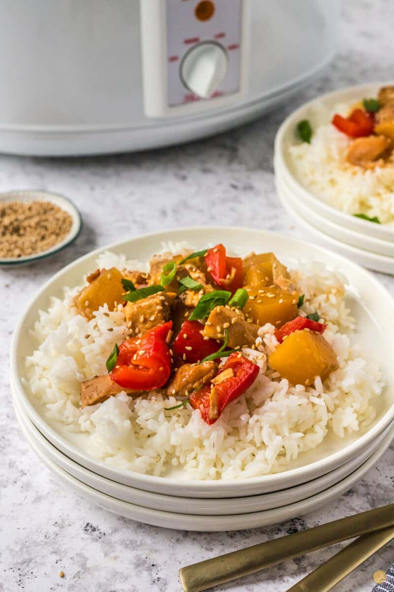 plate of chicken and pineapple over rice