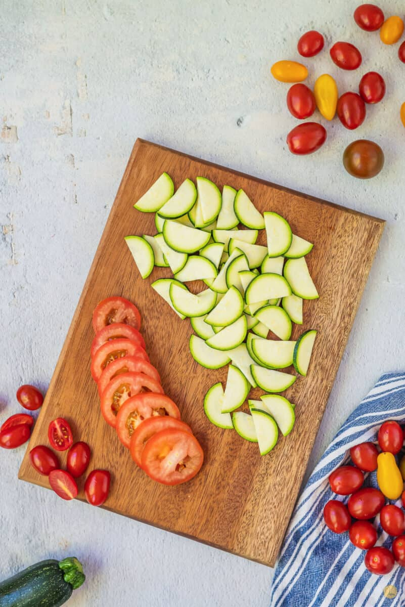 zucchini and tomatoes on a cutting board