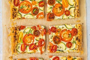 pieces of tomato zucchini tart