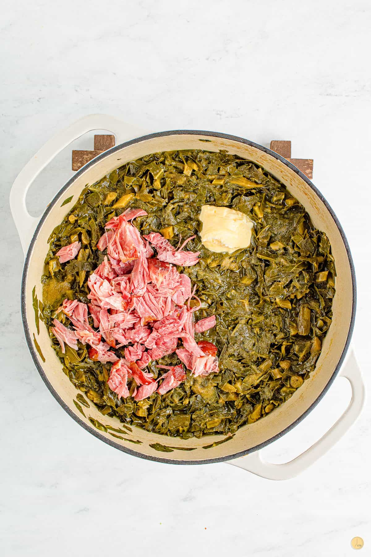 greens and ham in a pot