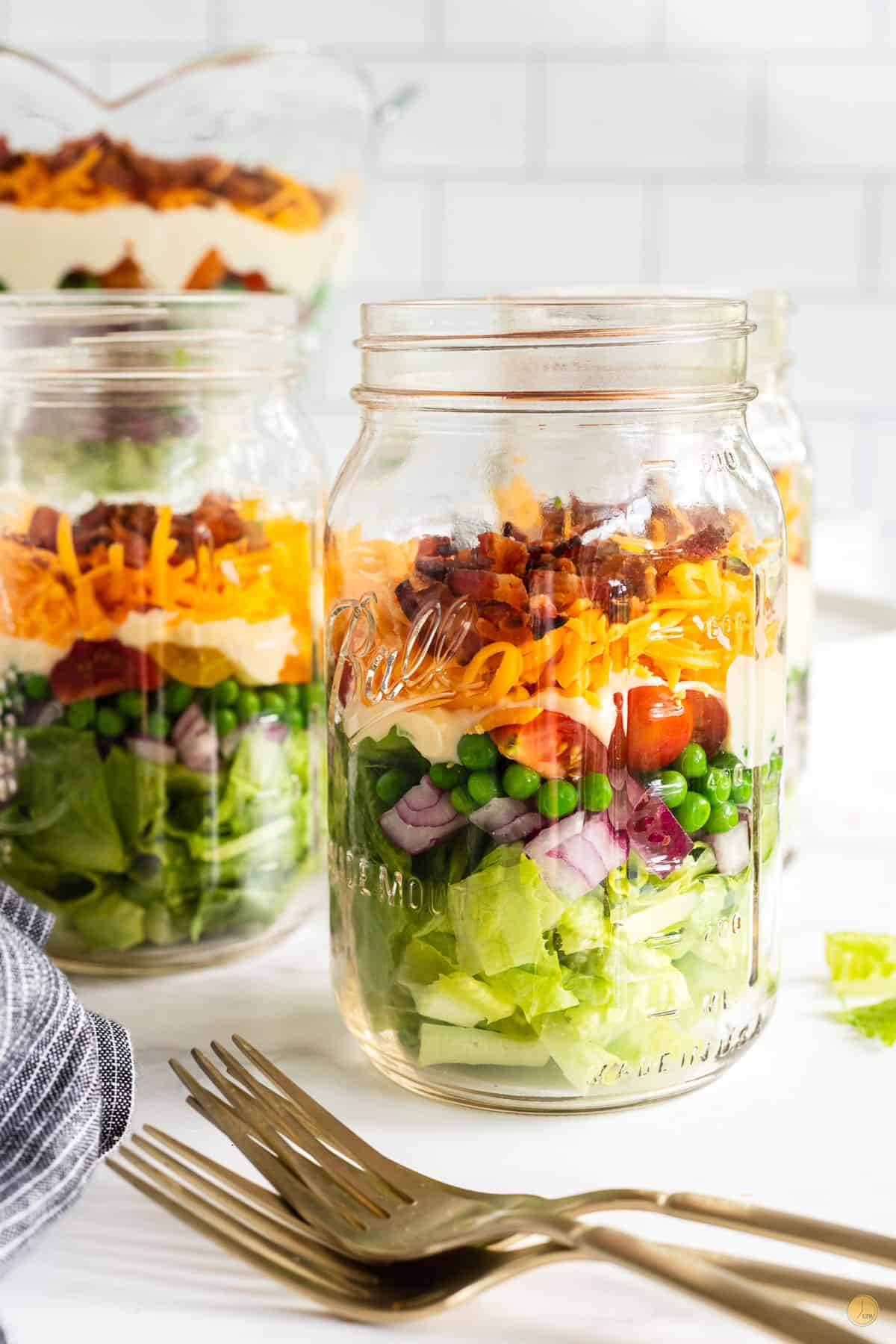 jars of 7 layer salad and forks