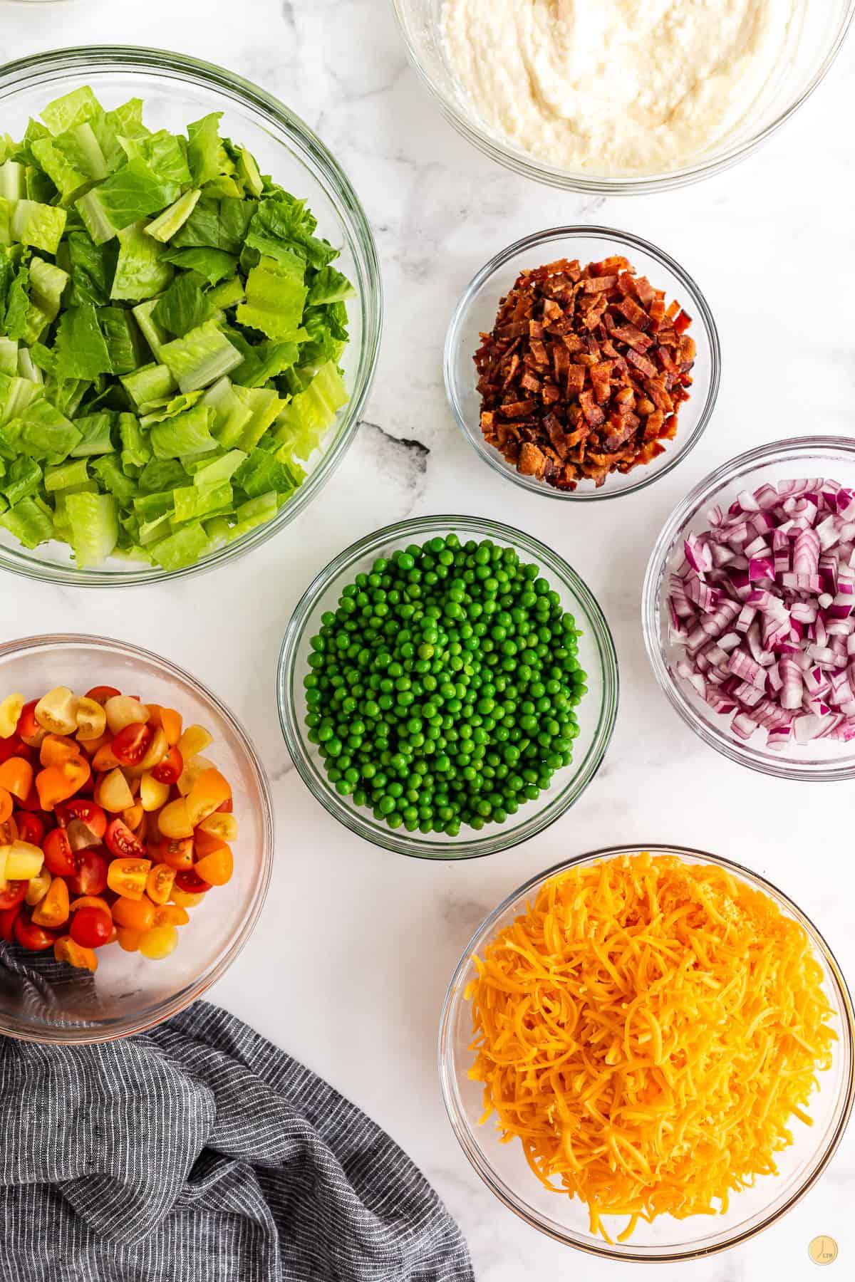bowls of salad ingredients