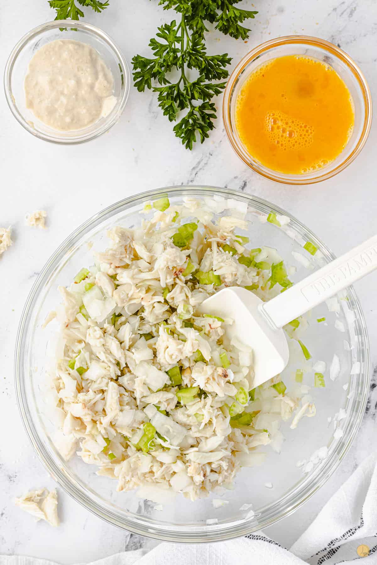 crab and celery in a bowl