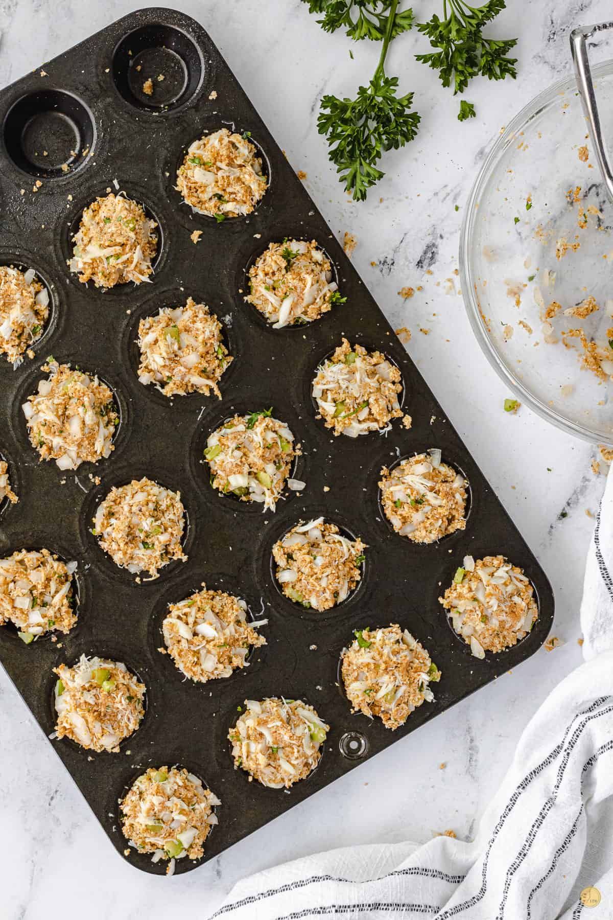 muffin pan with crab